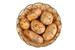 Potatis i korg Royaltyfri Fotografi