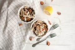 Potatis med calamarien och bacon fotografering för bildbyråer