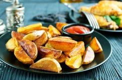 Potatis med fega vingar arkivbild