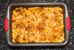 Potatis med ost och bröd Royaltyfri Foto