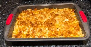 Potatis med ost och bröd Arkivfoto