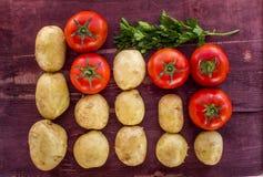 Potatis och tomat Arkivfoton