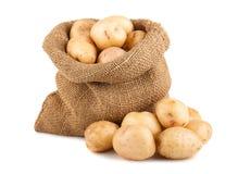 Potatisar i säck Arkivfoto