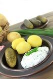 Potatisar och ostmassa Arkivbilder