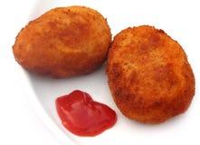 Potatiskotletter med tomatketchup Fotografering för Bildbyråer