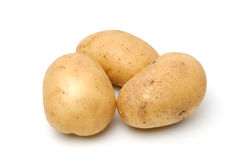 Potato. Three baking potatoes shot from a low angle Stock Image