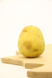 Potato. On isolated white background over wooden kitchen board Royalty Free Stock Image