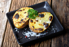 Potato baked and grill with charcoal fire Stock Images