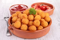 Potato ball and ketchup Stock Image