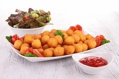 Potato ball and ketchup Royalty Free Stock Images