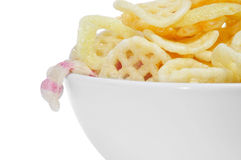 Potato based snacks. A bowl with different potato based snacks on a white background Stock Photo