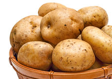 Potato basket close-up. Yellow potatoes in the basket close-up isolated on white background Royalty Free Stock Images