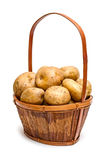 Potato basket. Yellow potatoes in the basket isolated on white background Royalty Free Stock Photography
