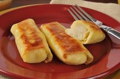 Potato blintzes. Golden potato blintzes closeup on a colorful plate Stock Photo