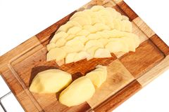 The potato on the board Stock Photography