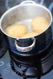 Potato boiling in water Royalty Free Stock Images