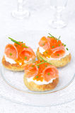 Potato bun with salted salmon, red caviar. Appetizer - potato bun with salted salmon, red caviar and green onion vertical Royalty Free Stock Photos