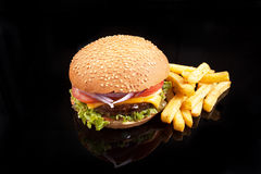 Potato and burger. Big burger, cheeseburger, French fries royalty free stock photos