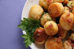 Potato cakes with bacon. Fried potato cakes with parsley on a white plate Stock Images
