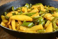 Potato Capsicum Curry Stock Images