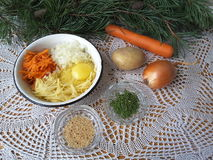 Potato carrot with pine needles fritters. Cooking vegetarian healthy food with pine needles royalty free stock photo