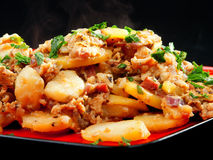 Potato casserole. On black background Stock Images