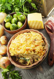 Potato casserole with brussel sprouts. And bacon Royalty Free Stock Images