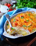 Potato casserole with chicken, onions and cheese Stock Photo