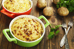 Potato casserole with meat. On the wooden table Stock Images