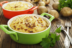 Potato casserole with meat. On the wooden table Royalty Free Stock Photos