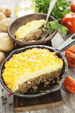 Potato casserole with meat. On the wooden table Stock Photography