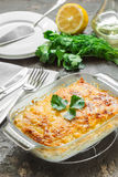 Potato casserole with melted cheese, green apple and lemon. Potato gratin with cream cheese and fresh herbs Royalty Free Stock Images