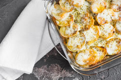 Potato casserole with sour cream sauce, vegetables and herbs, sp Royalty Free Stock Photography