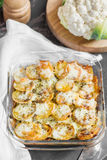 Potato casserole with vegetables and herbs, spicy sauce with sou Stock Images