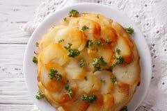 Potato casserole on a white plate closeup. Horizontal top view Royalty Free Stock Photos
