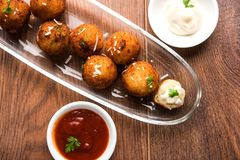 Potato cheese balls or croquettes or aloo tikki. Fried potato cheese balls or croquettes with tomato ketchup. Selective focus Royalty Free Stock Images