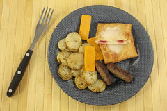 Potato Cheese Sausage Fork On Mat Royalty Free Stock Photography