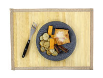 Potato Cheese Sausage Fork On Mat Top View Stock Photo