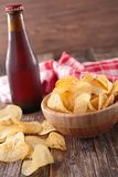 Potato chip and beer bottle Stock Photo