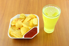 Potato chip and beverage Royalty Free Stock Images