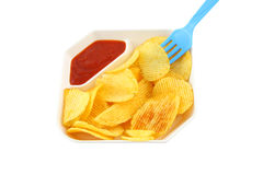 Potato chip and blue fork Stock Image