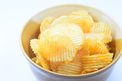 Potato chip. In a bowl on white background Royalty Free Stock Photography