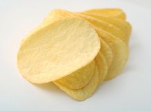 Potato chip. On grey background royalty free stock photos