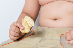 Potato chip in obese fat boy hand Stock Photo