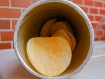 Potato chips. Potato chip  in a paper cylindrical bottle Stock Image