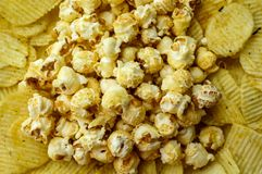 Potato chip and popcorn. Are unhealthy snack but very delicious Stock Photography