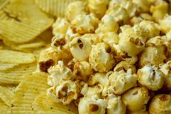 Potato chip and popcorn. Are unhealthy snack but very delicious Stock Photos