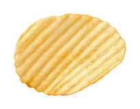 Potato Chip with Ridges isolated. A single wavy potato chip with ridges, sometimes called ruffles, isolated on a white background. A salty snack associated with Stock Photo