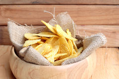 Potato chip on wood background Royalty Free Stock Image