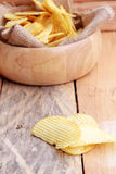 Potato chip on wood background Royalty Free Stock Photos
